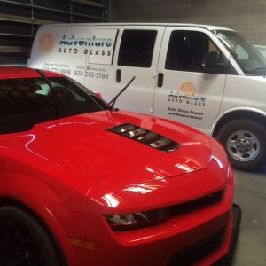 red camero in garage